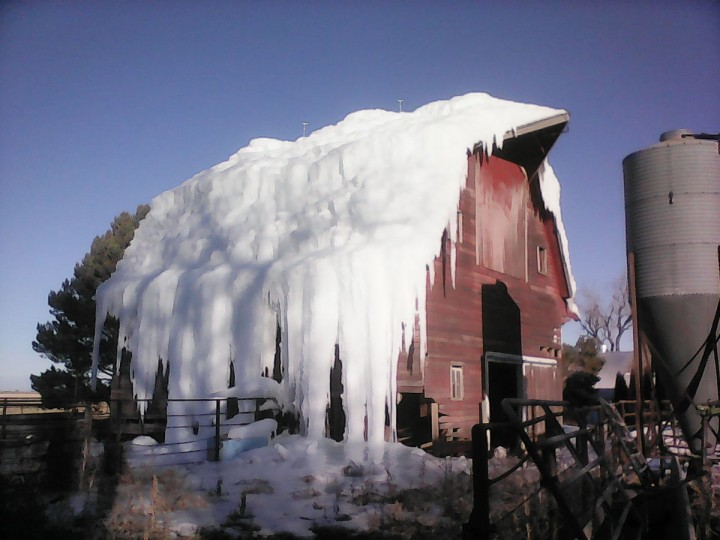 In this Jan. 17, 2015, photo, ice covers Bruce and Carol Anderbery's barn in rural Axtell, Neb. The Anderbery's wanted to make room for a new building on their farm by demolishing the old barn. According to the Daily Citizen, Bruce decided in December that pouring massive amounts of water on the barn was the easiest way to bring it down. (AP Photo/Daily Citizen, Brad Roberts)