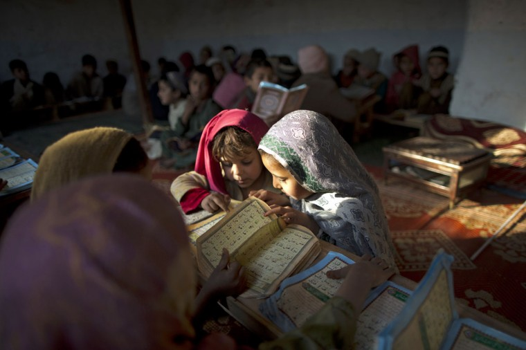 Internally displaced Pakistani children from tribal areas attend their daily Madrassa, or Islamic school on the outskirts of Islamabad, Pakistan, Monday, Jan. 19, 2015. (AP Photo/Muhammed Muheisen)