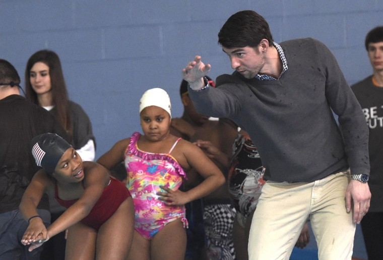"Olympic swimmer Michael Phelps, right, instructs Shakayla Blair, left, during swim team practice at the Haslam Family Club University, Wednesday, Jan. 28, 2015, in Knoxville, Tenn. Phelps coached the swim team on behalf of the Boys & Girls Clubs of the Tennessee Valley and participated in an announcement about the ""Our Kids, Our Future"" campaign. (AP Photo/Knoxville News Sentinel, Adam Lau)"