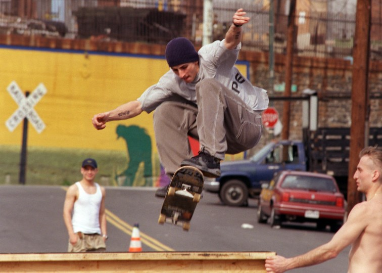 4/6/00-- Chris Kramer jumps over a homemade ramp that he and fellow SFPs (skaters from Pigtown) set up along James St. The skaters block off one lane of the road to set up the ramps. Elizabeth Mably/Baltimore Sun