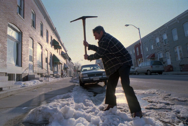 Feb. 18, 1994: Albert Withrow, of the 1200 block of Washington Blvd., was determinedto chip away the last of the mounded ice with his pick, so that tomorrow's sun could finish the job. (Amy Davis/Baltimore Sun)