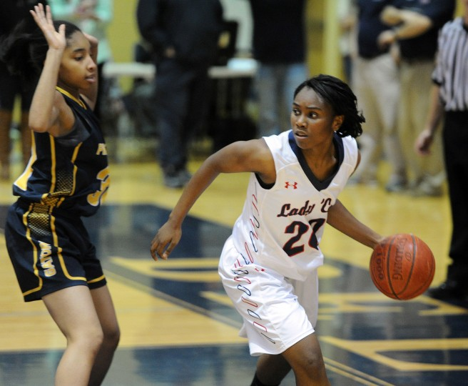 Bel Air's Catia Johnson looks to make a move toward the basket as Perry Hall's Amani West stays in position on defense during Monday night's game at Bel Air. (Matt Button/BSMG)