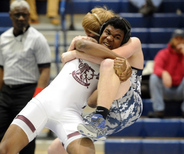 Havre de Grace's Dwayne Dixon takes down Bel Air opponent Trevor Proctor during Wednesday afternoon's meet at Bel Air. (Matt Button/BSMG)