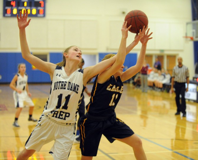 Notre Dame's Marisa DeLuca, left, fights for a rebound with and Annapolis Area Christian's Shannon Baden during a girls basketball game at Notre Dame Prep on Friday, January 9. (Brian Krista/BSMG)