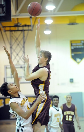 Hereford's Chase Waganer, right, releases a shot over Parkville's Evan Boone during a boys basketball game at Parkville High School on Friday, January 9. (Brian Krista/BSMG)