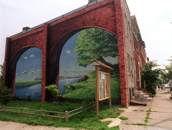 "6/25/99: Artist Mary Carfagno Ferguson, painted the mural ""Riverbank"" in the 900 block of Washington Blvd. in Pigtown three years ago. (Jed Kirschbaum/Baltimore Sun)"