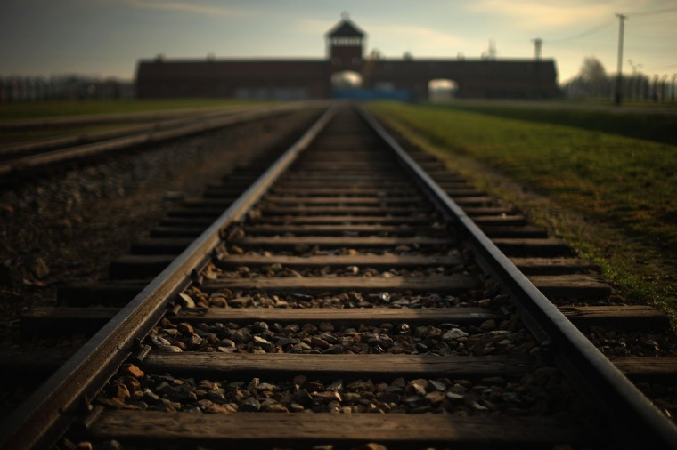 The railway track leads to the infamous 'Death Gate' at the Auschwitz II Birkenau extermination camp on November 12, 2014 in Oswiecim, Poland. (Photo by Christopher Furlong/Getty Images)