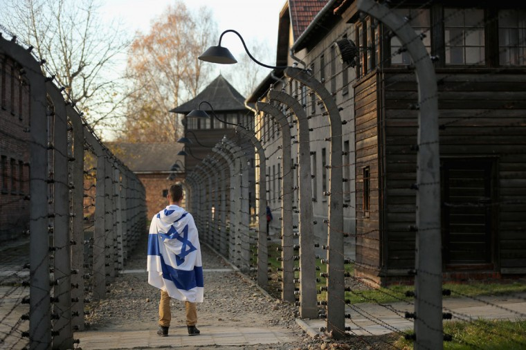 An Israeli teenager tours the Auschwitz I extermination camp on November 11, 2014 in Oswiecim, Poland. (Photo by Christopher Furlong/Getty Images)