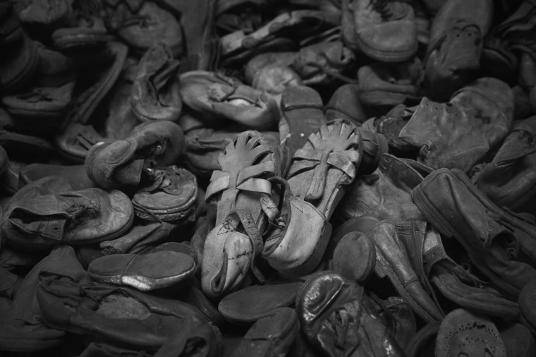 Children's shoes confiscated from Auschwitz prisoners lie in an exhibition display at the former Auschwitz I concentration camp, which today is a museum, on January 25, 2015 in Oswiecim, Poland. (Photo by Sean Gallup/Getty Images)