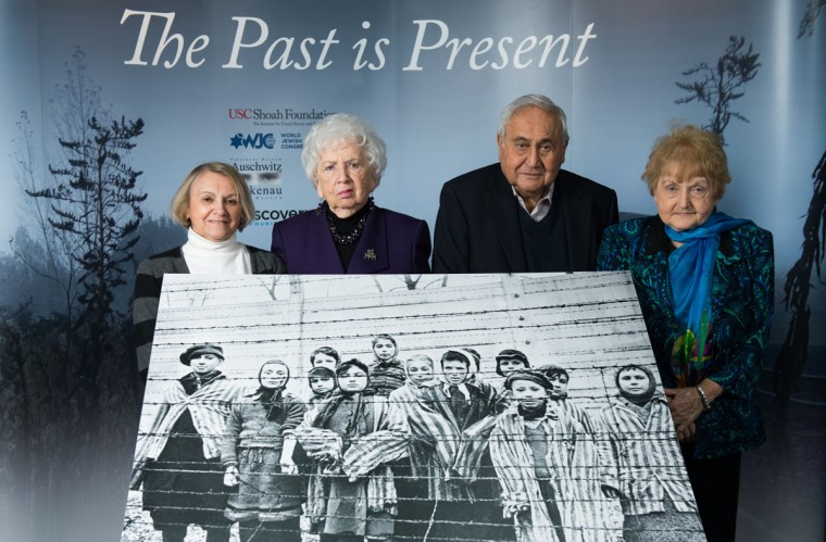 From left, 81-year-old Paula Lebovics, 79-year-old Miriam Ziegler, 85-year-old Gabor Hirsch and 80-year-old Eva Kor pose with the original image of them as children taken at Auschwitz at the time of its liberation on January 26, 2015 in Krakow, Poland. (Photo by Ian Gavan/Getty Images)