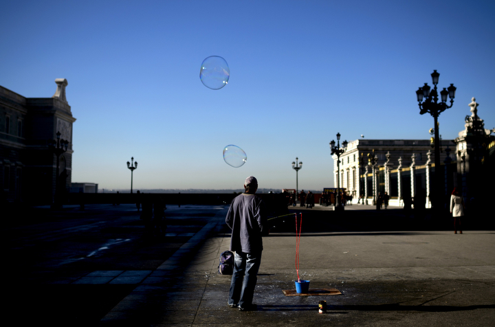 A man creates bubbles near the Royal on a sunny day in Madrid. (Dani Pozo/AFP-Getty Images)