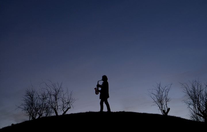 A man plays the saxophone in a park of Madrid. (Dani Pozo/AFP-Getty Images)