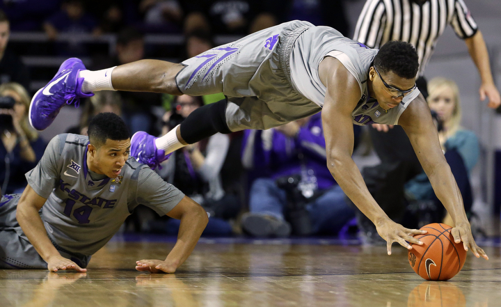 Kansas State's Stephen Hurt dives for a loose ball during the first half of an NCAA college basketball game against Baylor in Manhattan, Kan. (Charlie Riedel/AP Photo)