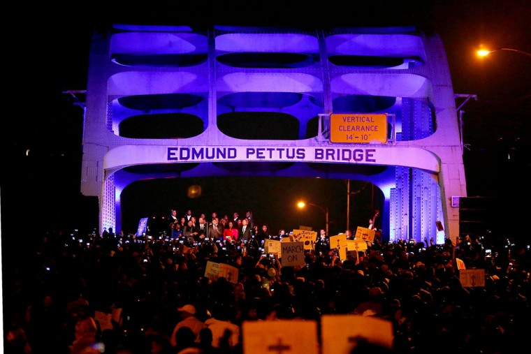 """Thousands march across the Edmund Pettus Bridge along with members of the cast of the movie """"Selma"""" in honor of Rev. Martin Luther King Jr. Day on January 18, 2015 in Selma, Alabama. In 1965, King led thousands of nonviolent protestors on a march through Selma to the state capitol in a historic Civil Rights demonstration. (Photo by Sean Gardner/Getty Images)"""