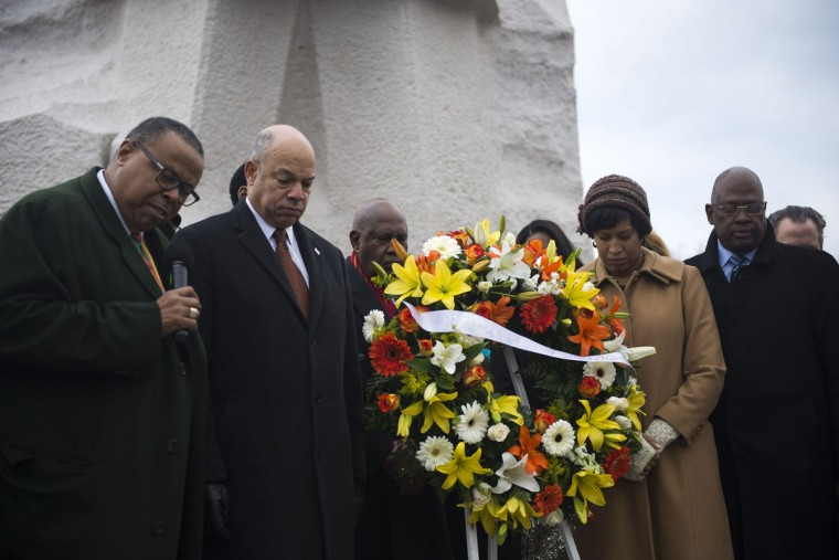 U.S. Secretary of Homeland Security Jeh Johnson (2nd from left) and Washington DC Mayor Muriel Bowser(2nd right) along with Harry Johnson (left), President and CEO of the Martin Luther King Jr. Memorial Foundation. participate in a wreath laying at the Martin Luther King Jr. Memorial during a ceremony on the National Mall on January 19, 2015 in Washington, D.C. Martin Luther King day was marked by many celebrations across the country. (Photo by Gabriella Demczuk/Getty Images)