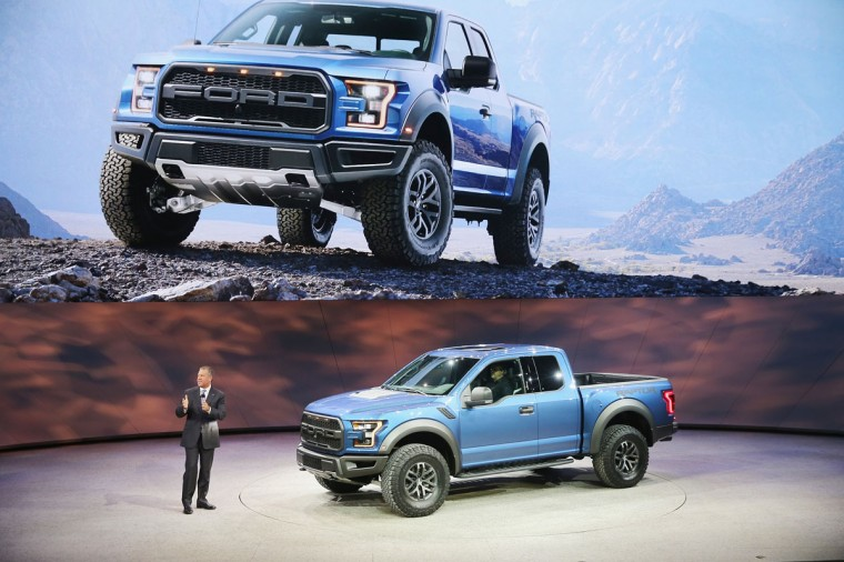 Joe Hinrich, President, the Americas at Ford Motor Company, introduces the new Ford F150 Raptor at the North American International Auto Show (NAIAS) on January 12, 2015 in Detroit. (Photo by Scott Olson/Getty Images)