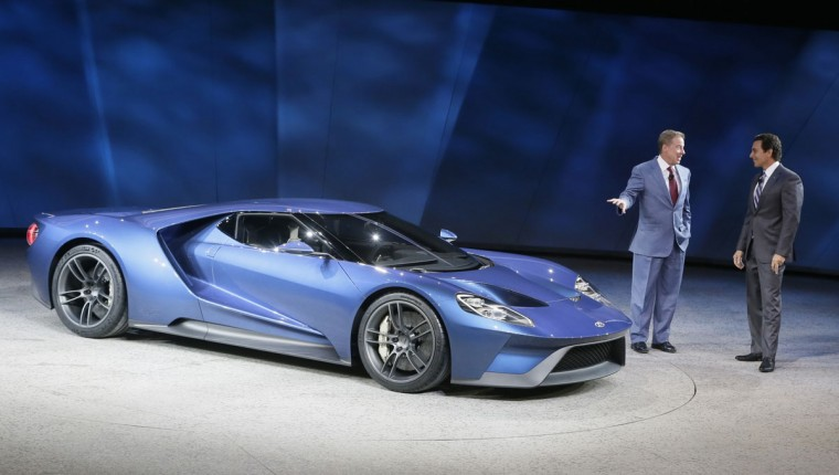 Ford Motor Co., Executive Chairman Bill Ford, left, and President and COO Mark Fields stand next to the new Ford GT during the North American International Auto Show, Monday, Jan. 12, 2015 in Detroit. (AP Photo/Carlos Osorio)