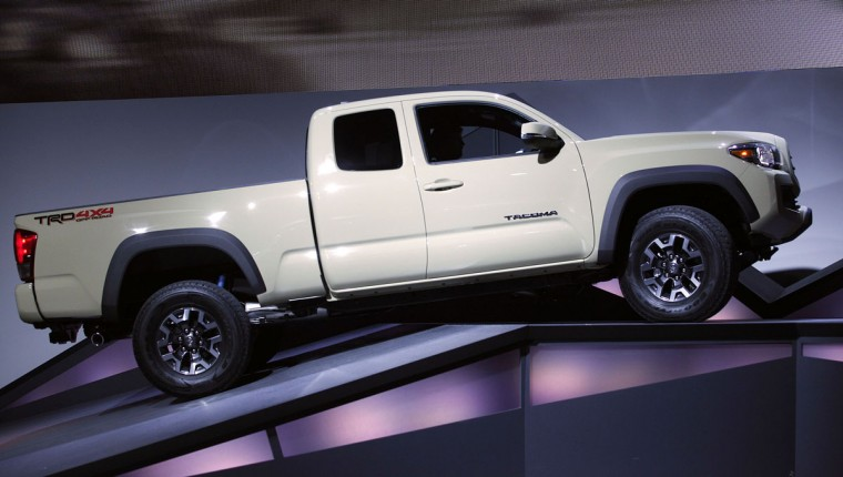 The new Toyota Tacoma TRD off-road truck is revealed to the media at the 2015 North American International Auto Show (NAIAS) on January 12, 2015 in Detroit. (Photo by Bill Pugliano/Getty Images)