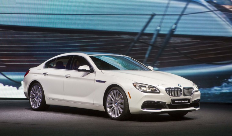 The new BMW 6 Series sedan is unveiled at the North American International Auto Show, Monday, Jan. 12, 2015, in Detroit. (AP Photo/Tony Ding)