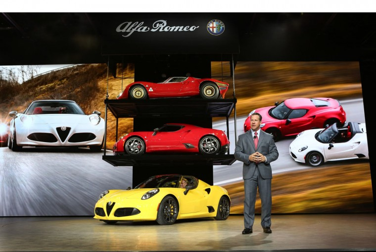 All-New 2015 Alfa Romeo 4C Spider World Premier Detroit - January 12, 2015 - Reid Bigland, Head of Alfa Romeo North America, unveiled the all-new 2015 Alfa Romeo 4C Spider at the North American International Auto Show today. Alfa Romeo 4C Spider delivers race-inspired performance, advanced technologies, seductive Italian style and now, an even more exhilarating driving experience with open-air freedom. (PRNewsFoto/FCA US LLC)