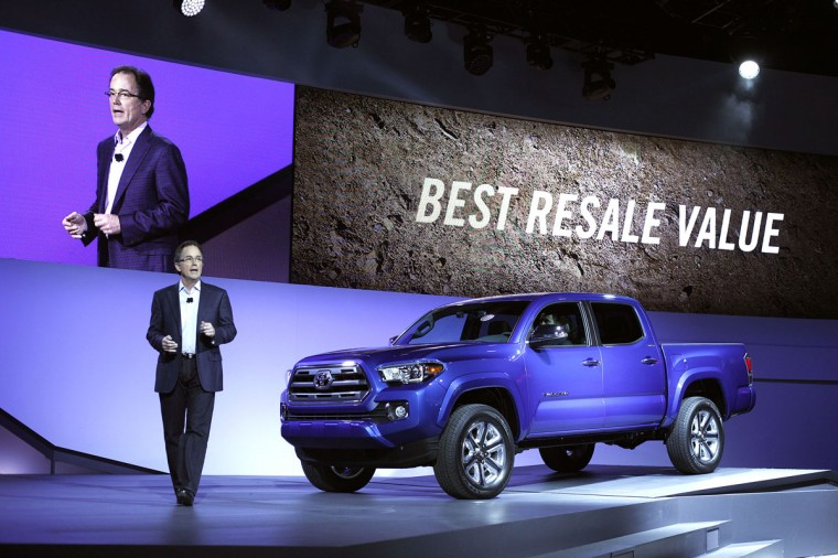 Bill Fay, Group Vice President and General Manager, Toyota Division, speaks at the new Tacoma midsize pickup truck reveal at the 2015 North American International Auto Show (NAIAS) on January 12, 2015 in Detroit. (Photo by Bill Pugliano/Getty Images)