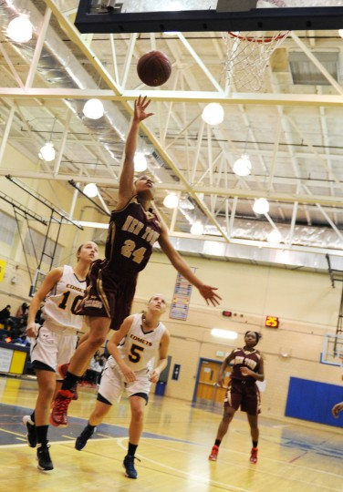 New Town's Sydney Hines goes airborne for a layup during a girls basketball game at Catonsville High School, Wednesday, Jan. 7, 2015. (Jon Sham/BSMG)