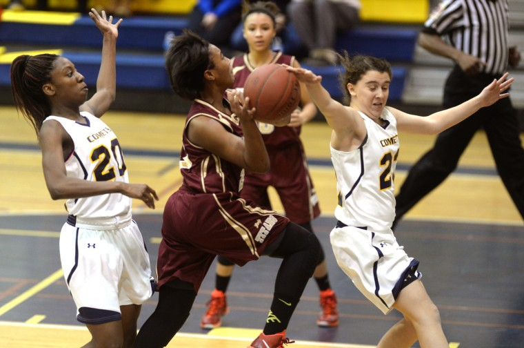 Catonsville's Andrea McTaggart, right, gets a hand on the ball as she and teammate Jasmine Pickey, left, defende New Town's Mariah Smith as she goes up for a shot during a girls basketball game at Catonsville High School, Wednesday, Jan. 7, 2015. (Jon Sham/BSMG)