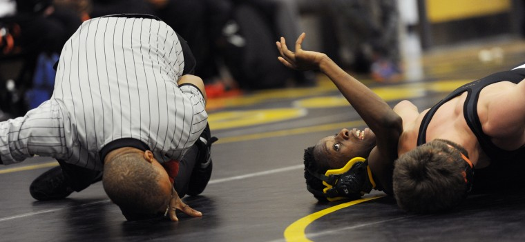 The referee gets a closer look as Oakland Mills' Matt Claxton, right, as he tries to pin Wilde Lake's Amenu McGruden during a wrestling tri-meet between Oakland Mills, Wilde Lake and Mt. Hebron at Mt. Hebron High School in Ellicott City, Thursday, Jan. 8, 2015. (Jon Sham/BSMG)