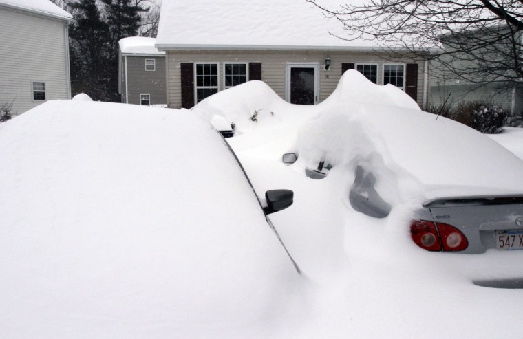Cars are buried by drifted snow from a winter snowstorm, Tuesday, Jan. 27, 2015, in Marlborough, Mass. (AP Photo/Bill Sikes)
