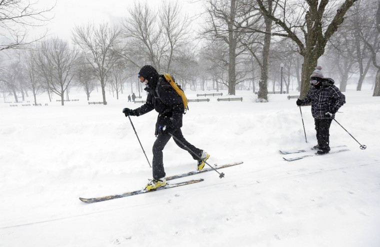 Cross-country skiers travels through the snow during a winter snowstorm Tuesday, Jan. 27, 2015, in Boston. Massachusetts was pounded by snow and lashed by strong winds early Tuesday as bands of heavy snow left some towns including Sandwich on Cape Cod and Oxford in central Massachusetts reporting more than 18 inches of snow. (AP Photo/Steven Senne)