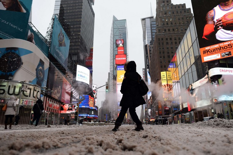 A few tourists wonder around nearly deserted New York's Times Square what is normally a crowed morning rush hour after a snowstorm on January 27, 2015. (JEWEL SAMAD/AFP/Getty Images)