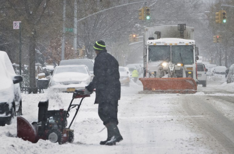 A sanitation truck plows snow along Foster Avenue in The Flatbush section of Brooklyn, following forecasters call for a winter emergency, Tuesday, Jan. 27, 2015, in New York. (AP Photo/Bebeto Matthews)