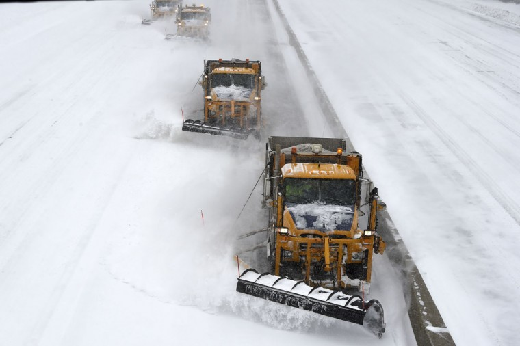 New York State Department of Transportation plows clear snow off the Long Island Expressway after it was reopened on Tuesday, Jan. 27, 2015, in Melville, N.Y. (AP Photo/Kathy Kmonicek)