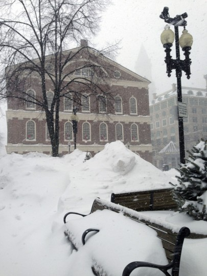 A bench sits buried by drifted snow adjacent to Faneuil Hall in Boston during a winter snowstorm Tuesday, Jan. 27, 2015. (AP Photo/Dwayne Desaulniers)