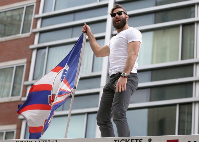 Julian Edelman of the New England Patriots celebrates during a Super Bowl victory parade on February 4, 2015 in Boston, Massachusetts. The Patriots defeated the Seattle Seahawks 28-24 in Super Bowl XLIX. (Photo by Billie Weiss/Getty Images)