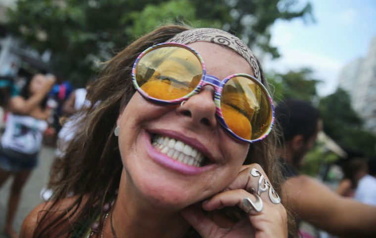 A reveler smiles while posing during a 'bloco' street parade during pre-Carnival festivities on February 7, 2015 in Rio de Janeiro, Brazil. Carnival officially starts February 13 but pre-Carnival festivities are already underway in Brazil. (Photo by Mario Tama/Getty Images)