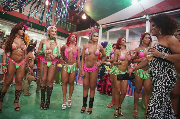 Beauty contestants stand during the Gay Glam Ball inside the Mangueira samba school on February 11, 2015 in Rio de Janeiro, Brazil. Carnival runs this year February 13-17. (Photo by Mario Tama/Getty Images)