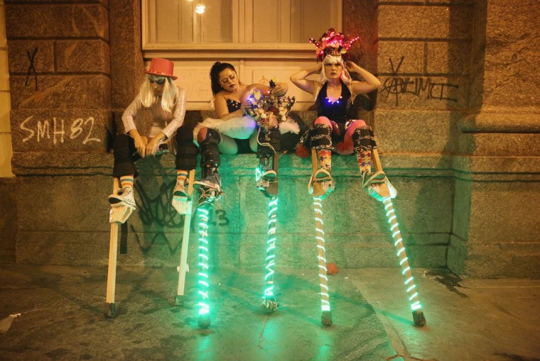 Stilt-walkers prepare to perform for revelers during the My Light is LED 'bloco' pre-Carnival street parade on February 12, 2015 in Rio de Janeiro, Brazil. Carnival runs this year February 13-17. (Photo by Mario Tama/Getty Images)