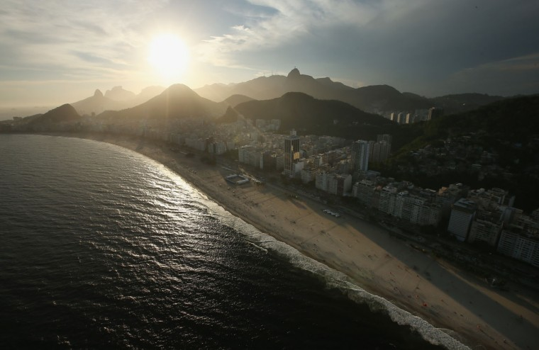 The sun begins to set over Copacabana beach, which will host beach volleyball, open water marathon and triathlon for the Rio 2016 Olympic Games, on February 24, 2015 in Rio de Janeiro, Brazil. The city of Rio continues to prepare to host the upcoming Olympic Games which kickoff on August 5, 2016. (Photo by Mario Tama/Getty Images)