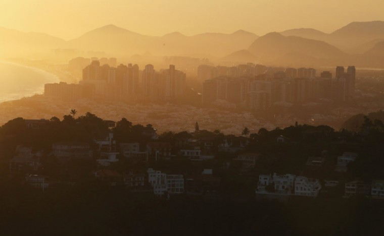 The sun begins to set over the Barra da Tijuca neighborhood, which will host the primary venue cluster for the Rio 2016 Olympic Games, on February 24, 2015 in Rio de Janeiro, Brazil. The city of Rio continues to prepare to host the upcoming Olympic Games which kickoff on August 5, 2016. (Photo by Mario Tama/Getty Images)