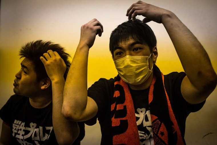 Student wrestlers put gel in their hair prior to a fight during the Student Pro-Wrestling Summit on February 26, 2015 in Tokyo, Japan. (Photo by Chris McGrath/Getty Images)