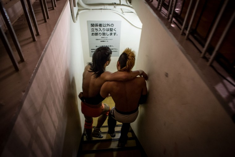 A student wrestler is helped back to the dressing room by his team mate after their fight during the Student Pro-Wrestling Summit on February 26, 2015 in Tokyo, Japan. (Photo by Chris McGrath/Getty Images)