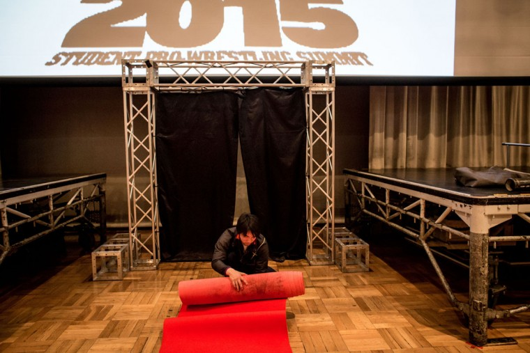 A student wrestler rolls up the red carpet after the night's fights during the Student Pro-Wrestling Summit on February 26, 2015 in Tokyo, Japan. (Photo by Chris McGrath/Getty Images)