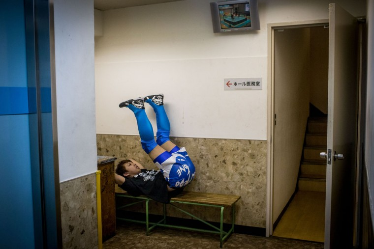 A student wrestler warms-up in the hallway ahead of his fight during the Student Pro-Wrestling Summit on February 26, 2015 in Tokyo, Japan. (Photo by Chris McGrath/Getty Images)