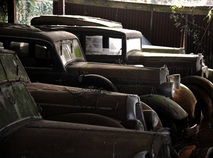 """This file photo taken on November 26, 2014 in makeshift shelters at the Gaillard property in the western French town of Echire, shows a collection of 60 antique cars, dating from the '30s to the '70s, including Bugatti, Hispano-Suiza, Delahaye, Maserati and Ferrari models, some of them rare, are parked on . The cars, called by experts """"an automobile Graal,"""" were collected by Roger Baillon, who died in the early 2000s before being able to open a car museum as he had wanted to. The rare car collection, estimated at was auctioned off on December 6 by Artcurial during the Retromobile fair in Paris. (Xavier Letoy/AFP/Getty Images)"""
