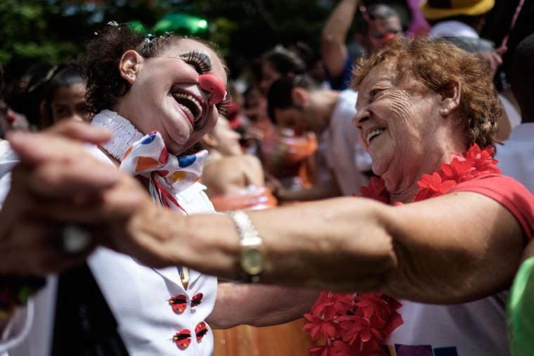 Revelers of Bloco Gigantes da Lira dance on a street during the pre-carnival parade in Rio de Janeiro, Brazil on February 8, 2015. (Yasu Yoshi Chiba/AFP/Getty Images)