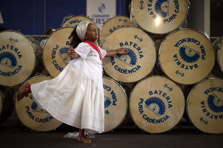 A girl of the Afro-American religion Candomble poses next to drums before the cleansing ceremony of the Sambodrome in Rio de Janeiro, Brazil, on February 8, 2014. Samba schools will parade at the Sambodrome next February 15 and 16, 2015. (Yasu Yoshi Chiba/AFP/Getty Images)