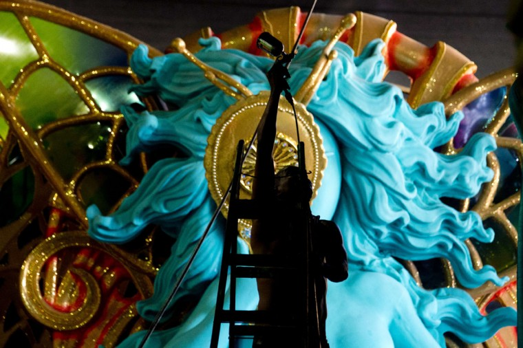 Members of the Uniao da Ilha do Governador samba school work on a float at Samba City in Rio de Janeiro, Brazil on February 11, 2015. The world famous carnival parade will take place in the Sambadrome next February 16 and 17. (Vander El Almeida/AFP/Getty Images)