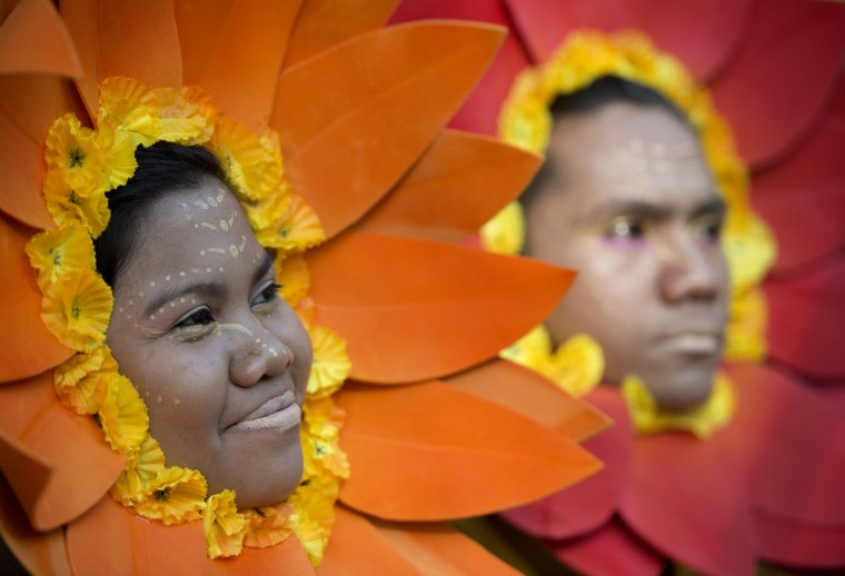 Students wearing flower costumes wait to dance during the annual Caracol Festival in Manila on February 22, 2015. Participants of the Caracol Festival dress in different costumes of wildlife and endangered species to express the need to preserve Manila's environment and cultural heritage. (Noel Celis/AFP/Getty Images)
