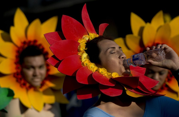 A student wearing a flower costume waits to dance during the annual Caracol Festival in Manila on February 22, 2015. Participants of the Caracol Festival dress in different costumes of wildlife and endangered species to express the need to preserve Manila's environment and cultural heritage. (Noel Celis/AFP/Getty Images)
